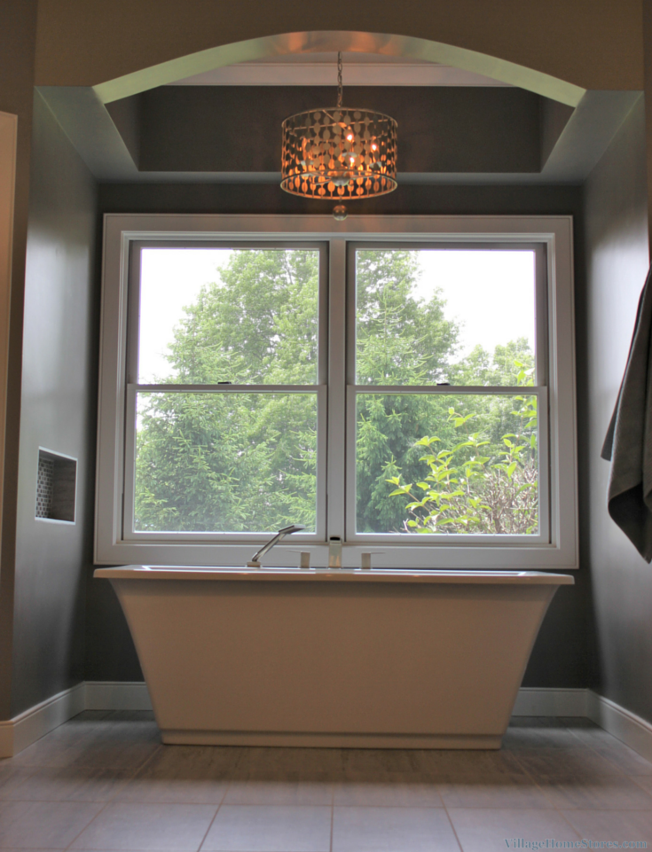 Chandelier above the bathtub. | VillageHomeStores.com