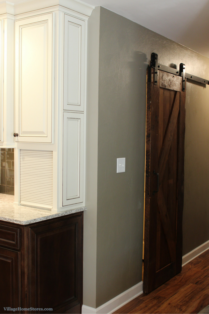 Sliding barn door in kitchen remodel by Village Home Stores