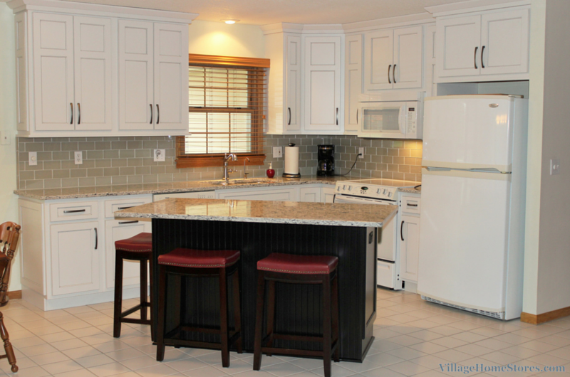 White painted kitchen with black island village home stores for Remodel kitchen without replacing cabinets
