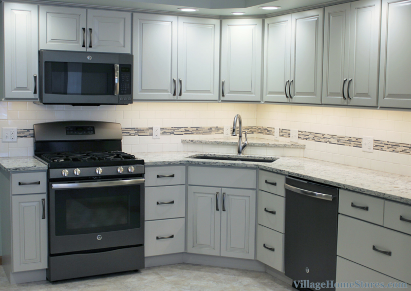 Dura Supreme Pearl Painted Kitchen with Slate Accent. | VillageHomeStores.com