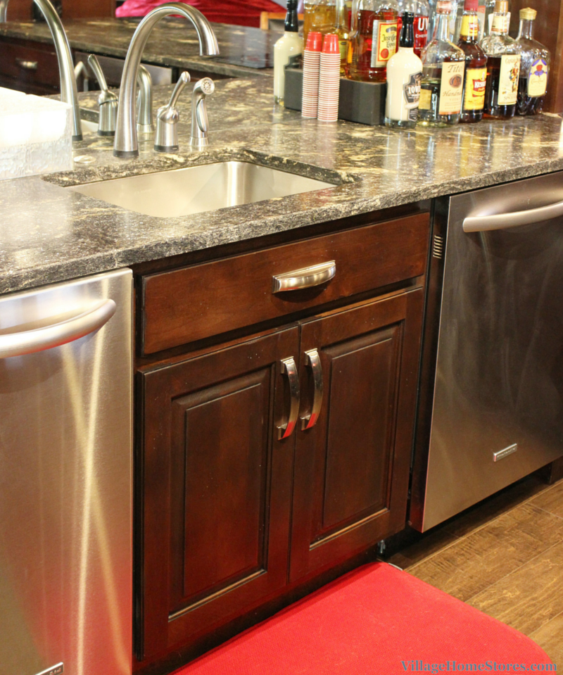 Bar sink in a home bar designed by Village Home Stores. | VillageHomeStores.com