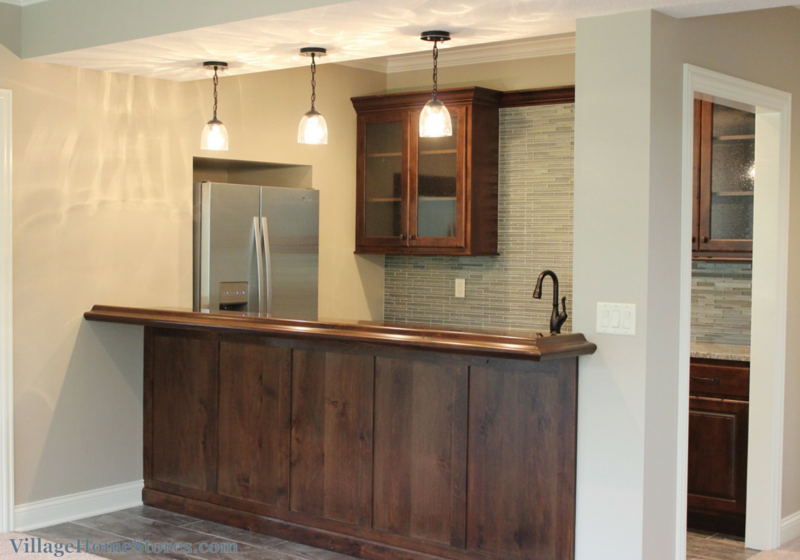 wet bar cabinets in a lower level of a Bettendorf, IA home. | VillageHomeStores.com