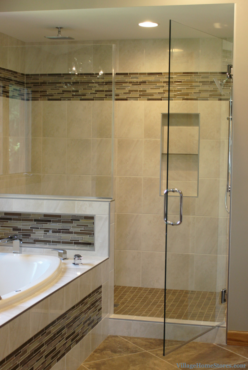 Tiled walk in shower and tub in remodeled master bathroom. | VillageHomeStores.com