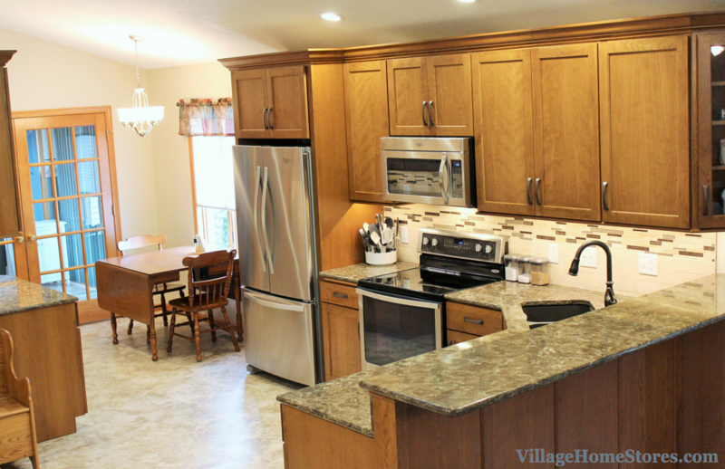 Cherry kitchen cabinets in remodeled space by Village Home Stores. | VillageHomeStores.co,