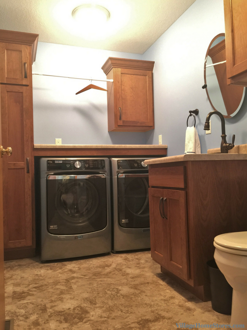 A four cabinet laundry room layout. | VillageHomeStores.com