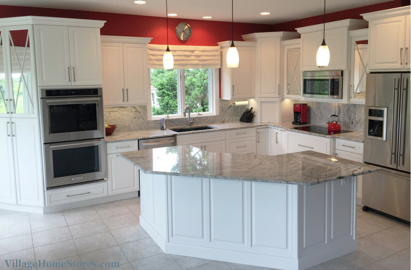 White painted kitchen with full height granite backsplash. | VillageHomeStores.com