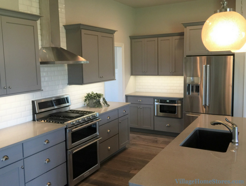Mixed grays and woodtones in kitchen design by Village for Edgebrooke Homes. | VillageHomeStores.com