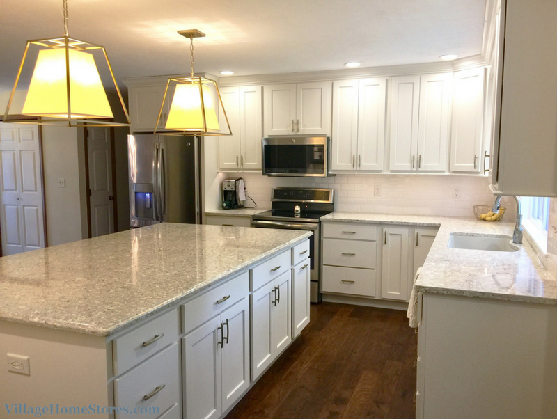 White painted kitchen with largeb island in Davenport Iowa. | VillageHomeStores.com