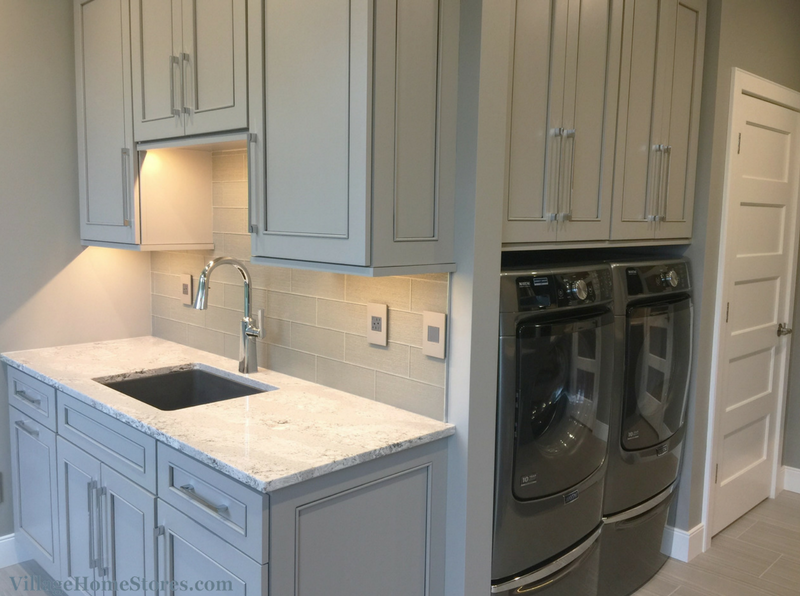 DuraSupreme's painted Zince gray finish in a Laundry Room design including Cambria quartz. | VillageHomeStores.com