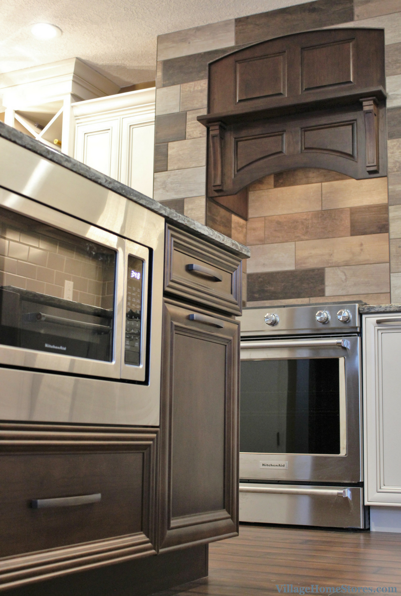 Microwave with trim kit in a Colona, IL kitchen island. | VillageHomeStores.com