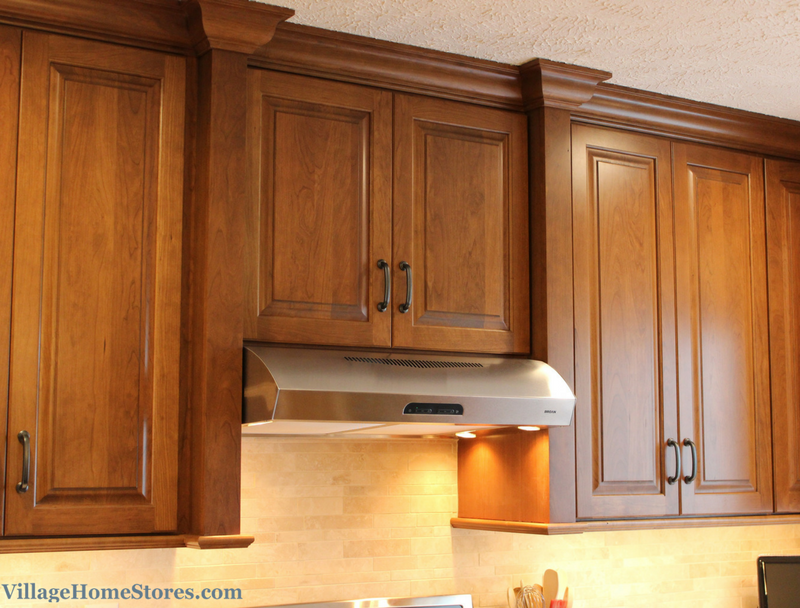 DuraSupreme's Cherry Clove finish on a wood hood surround. | VillageHomeStores.com