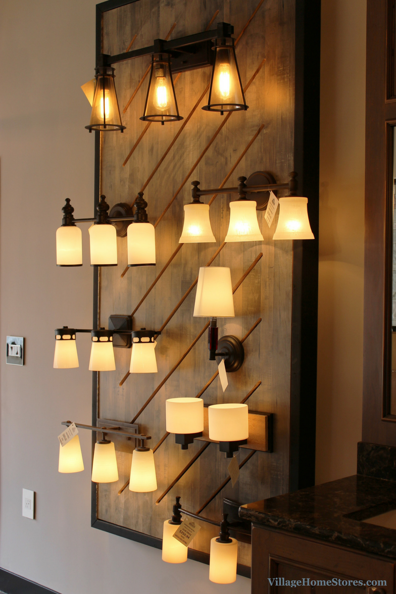 Creative wall-mount lighting display in Village Home Stores showroom. | VillageHomeStores.com
