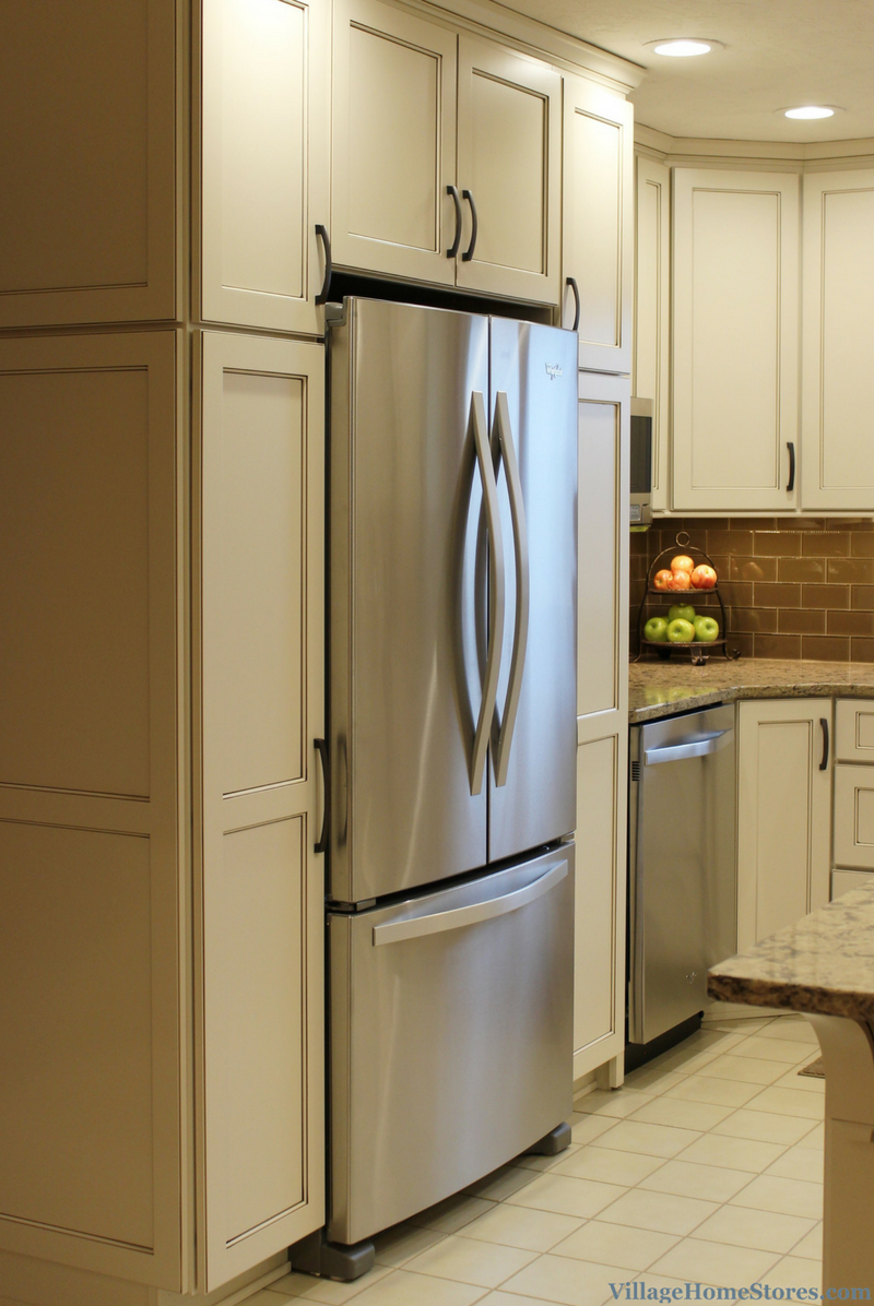 Tall pantries surround a refrigerator. | VillageHomeStores.com