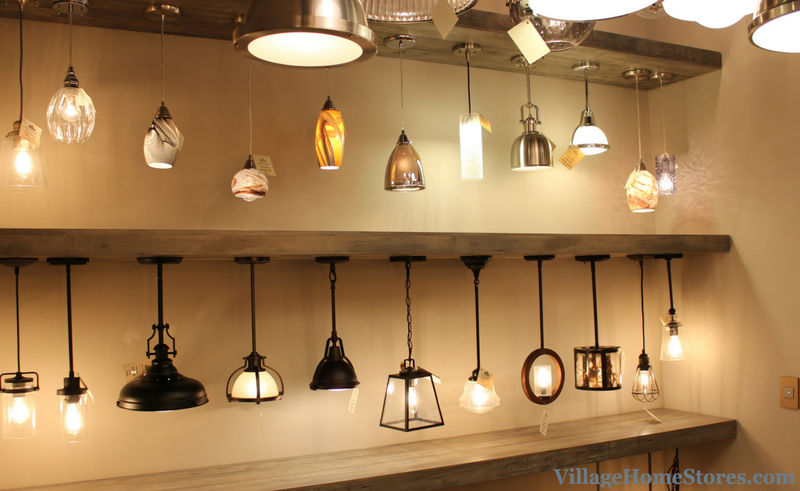 Creative pendant lighting display wall in Village Home Stores showroom. | VillageHomeStores.com