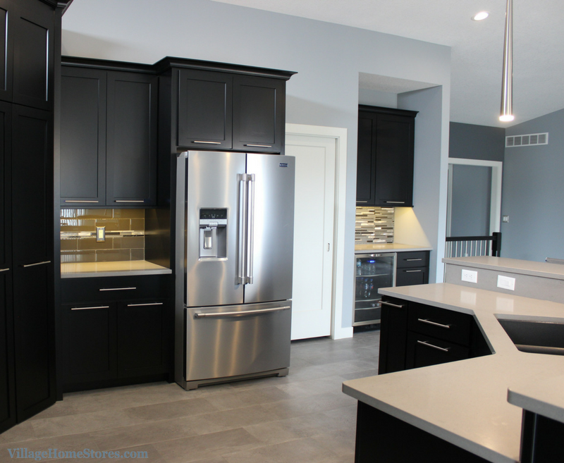 Contemporary style kitchen in a home by Heartland Builders including Stainless Maytag Appliances. | VillageHomeStores.com