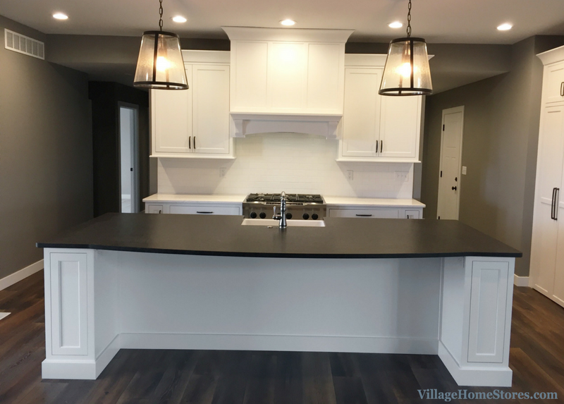 Large kitchen island with brushed granite counters. | VillageHomeStores.com