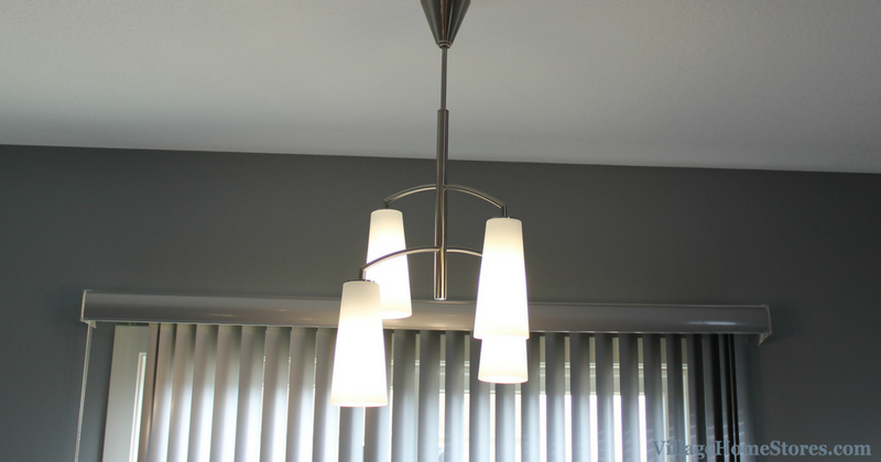 4 light Coddington chandelier by Feiss in a home by Heartland Builders. | VillageHomeStores.com