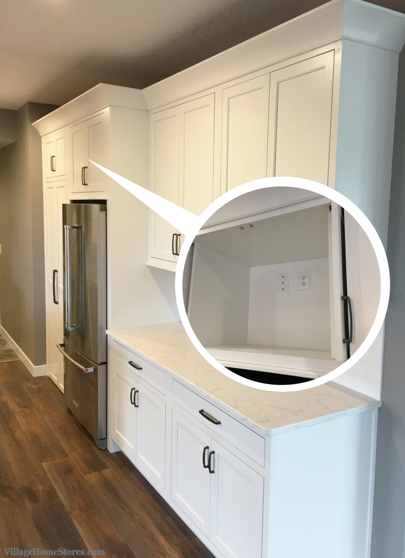 TV hidden in kitchen above refrigerator. | VillageHomeStores.com