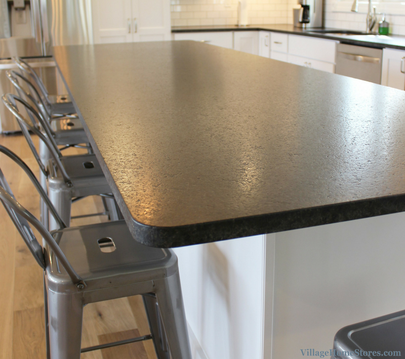 Brushed Black Pearl granite counters in a Modern Farmhouse style kitchen. | VillageHomeStores.com