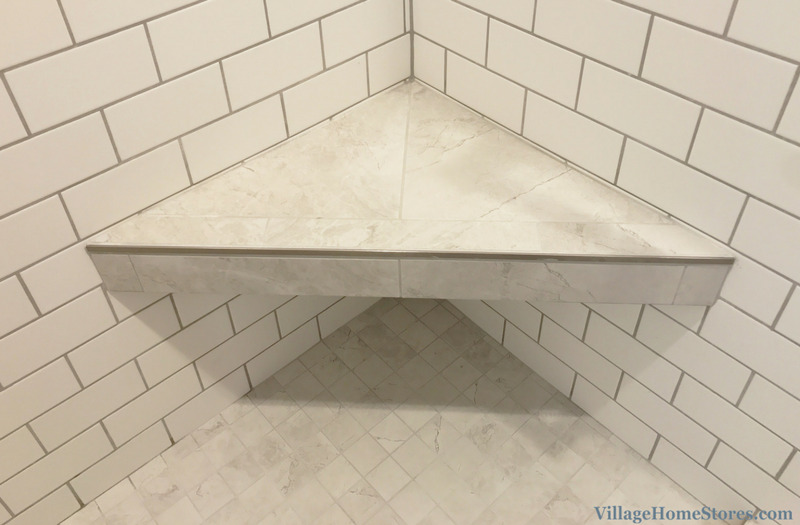 A Davenport, IA bathroom including tiled corner bench. Bath remodeled completely from start to finish by Village Home Stores. | VillageHomeStores.com
