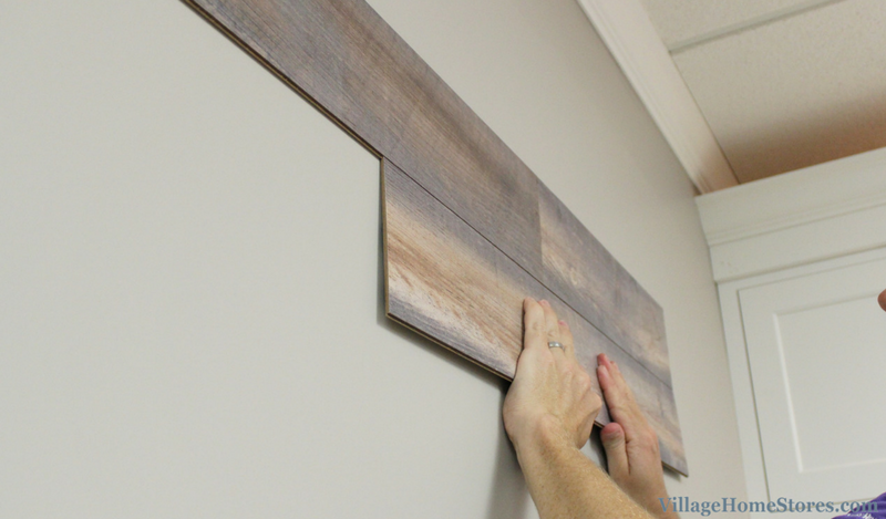 Wallplank installation- slide ridged edge into seam area before allowing adhesive touch wall surface. | VillageHomeStores.com