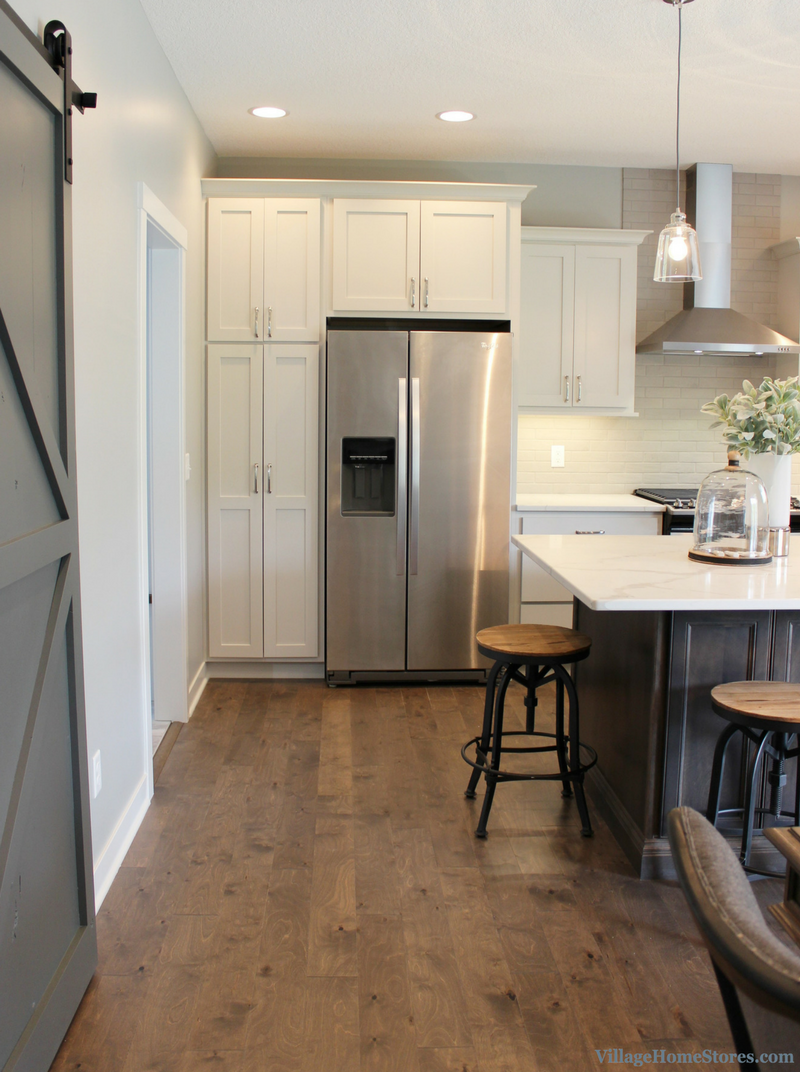Kitchen with side-by-side Whirlpool refrigerator. Kitchen by Village Home Stores for Wood Builder Ltd. | VillageHomeStores.com