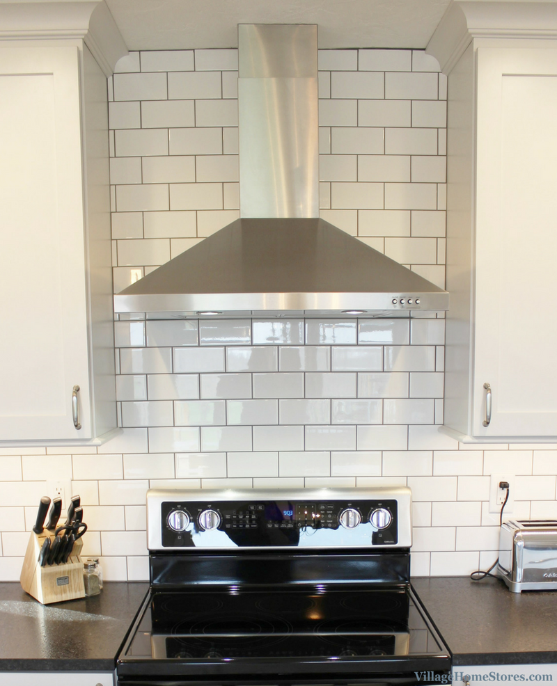 A Geneseo, IL kitchen with stainless hood and subway tile all the way to ceiling. | VillageHomeStores.com