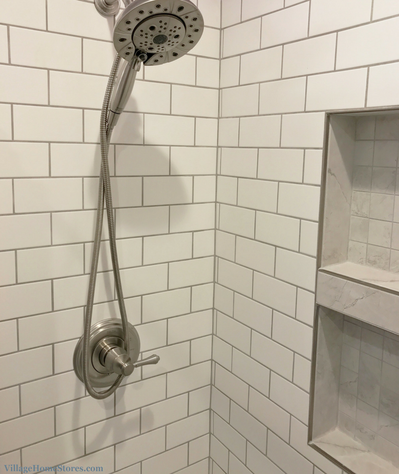 A Davenport, IA bathroom designed and remodeled completely from start to finish by Village Home Stores including a custom tiled shower. | VillageHomeStores.com
