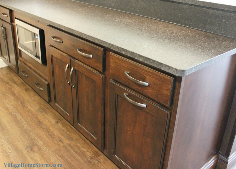 A Bettendorf wet bar with Mocha stained cabinetry and brushed finish granite tops. Design by Village Home Stores for Heartland Builders. | VillageHomeStores.com
