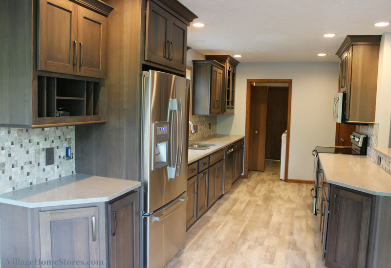 A gray hickory stained Bettendorf, IA galley kitchen designed by Chris Robinson and remodeled completely from start to finish by Village Home Stores. | VillageHomeStores.com