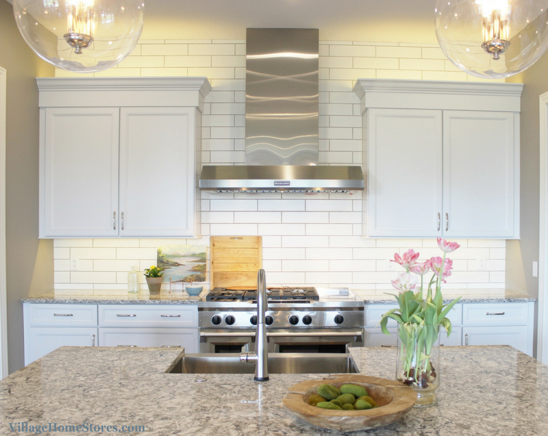 White painted kitchen with Koch cabinetry and KitchenAid appliances. Design and material selection by Village Home Stores for Heartland Builders. | VillageHomeStores.com