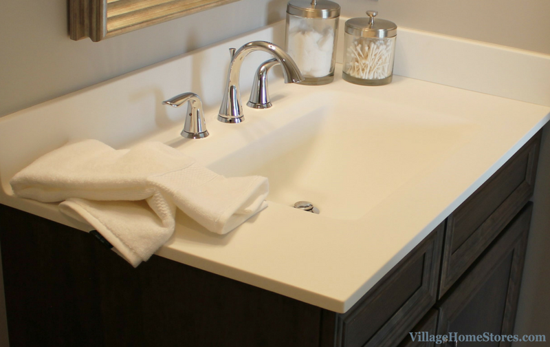 Onyx Collection vanity top with integrated bowl in a Bettendorf, IA home. Design and materials by Village Home Stores for Aspen Homes LLC. | VillageHomeStores.com