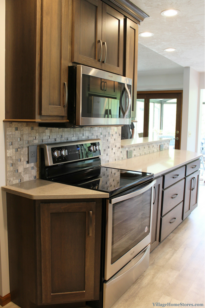 A gray hickory stained Bettendorf, IA galley kitchen with Whirlpool appliances. | VillageHomeStores.com