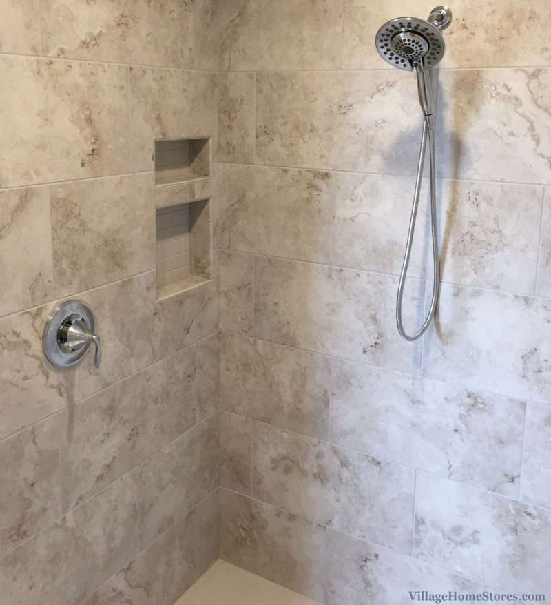 Custom tiled shower with tiled niche shelf in a home built by Hazelwood Homes. | VillageHomeStores.com