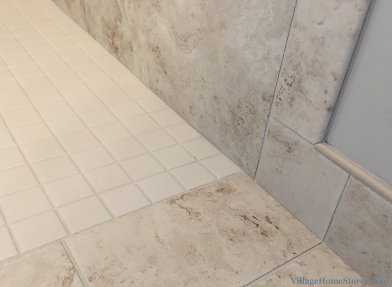 Custom tiled ADA shower with no threshold entry in a home built by Hazelwood Homes. | VillageHomeStores.com