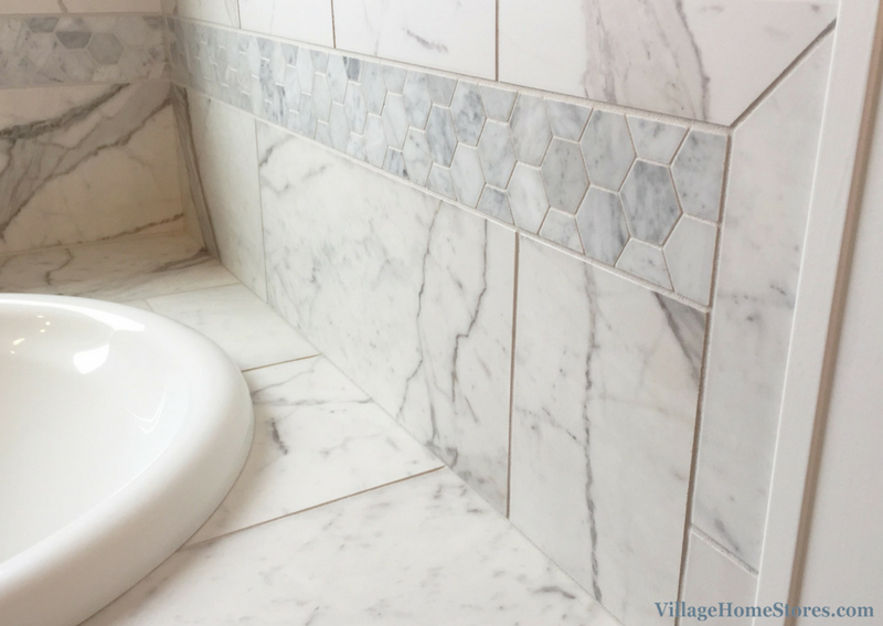 Hexagon Carrara White marble mosaic tile in a home built by Hazelwood Homes. | VillageHomeStores.com