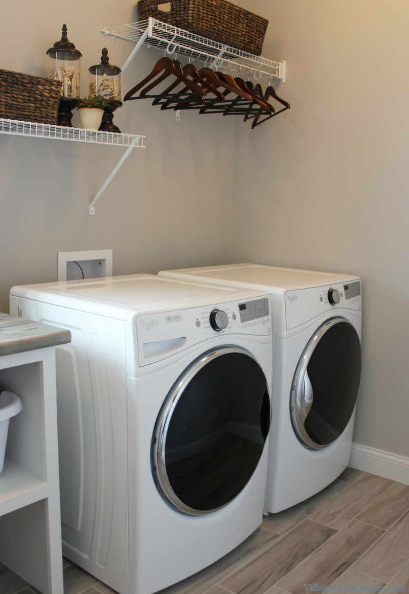 Whirlpool front-load laundry pair in a Bettendorf, IA home. Design and materials by Village Home Stores for Aspen Homes LLC. | VillageHomeStores.com