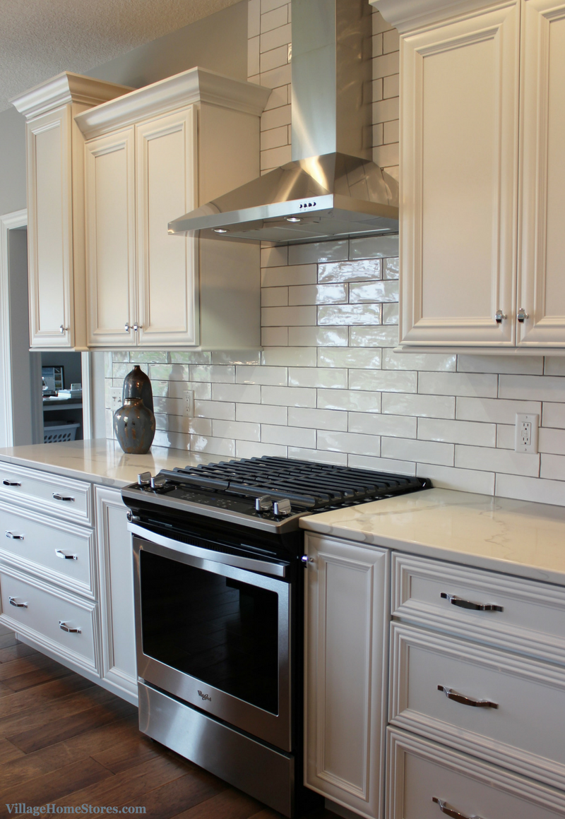 White kitchen with long subway tile Design and materials by Village Home Stores for Aspen Homes LLC. | VillageHomeStores.com