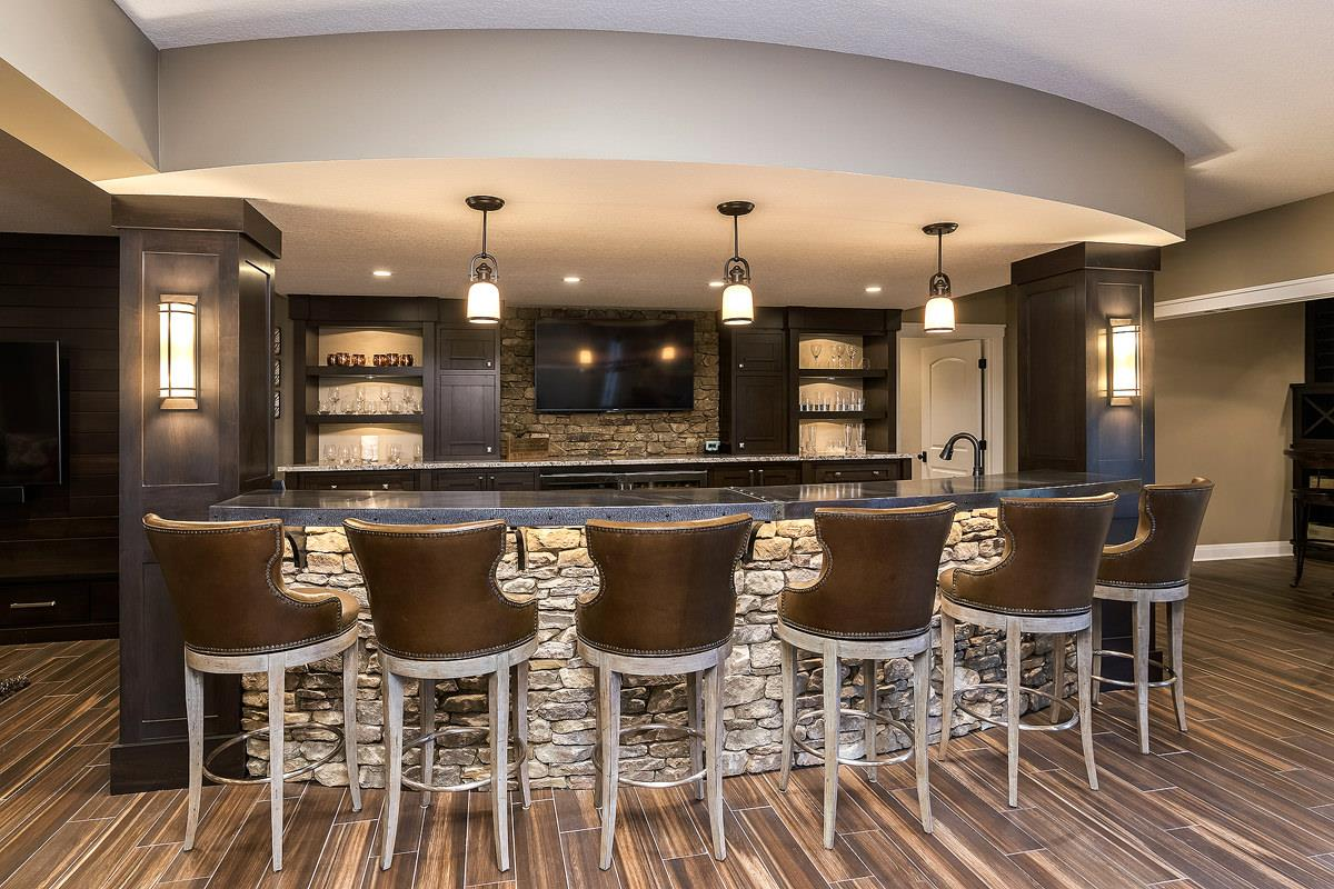Custom bar area cabinetry in a new home built by Bob Walter Homes. Styled by Elements Interior Design QC | VillageHomeStores.com | Photo by Andy Laake, Chipshot Media