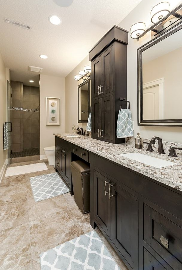 Custom bathroom cabinetry in a new home built by Bob Walter Homes. | VillageHomeStores.com | Photo by Andy Laake, Chipshot Media