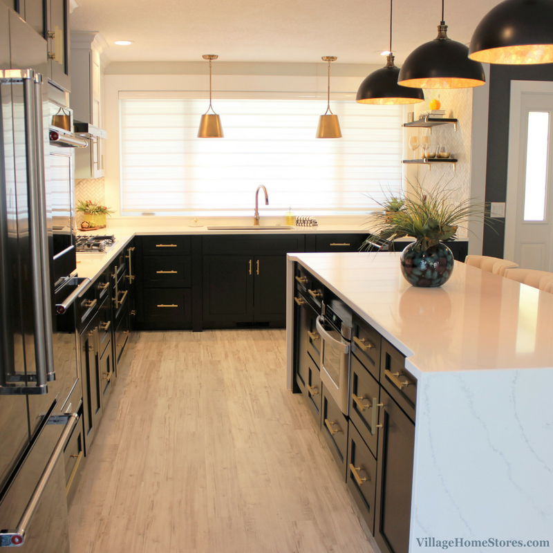 Black and White painted kitchen with Black Stainless Steel appliances by KitchenAid and Hanstone Quartz. | VillageHomeStores.com