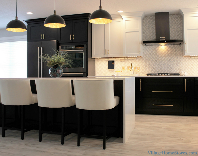 Black base cabinets and White upper cabinets paired with quartz counters. | VillageHomeStores.com