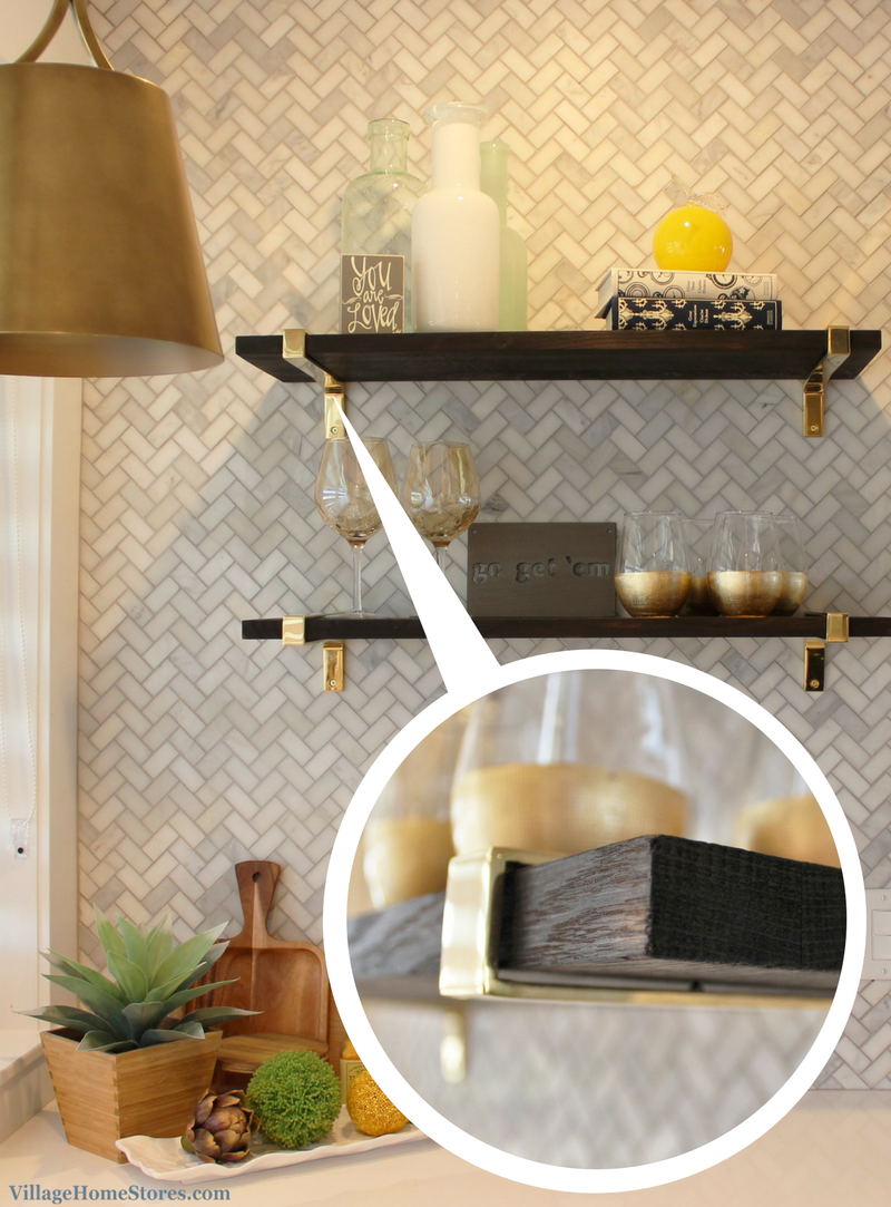 Gold brackets and charred black shelves in a black and white kitchen. | VillageHomeStores.com