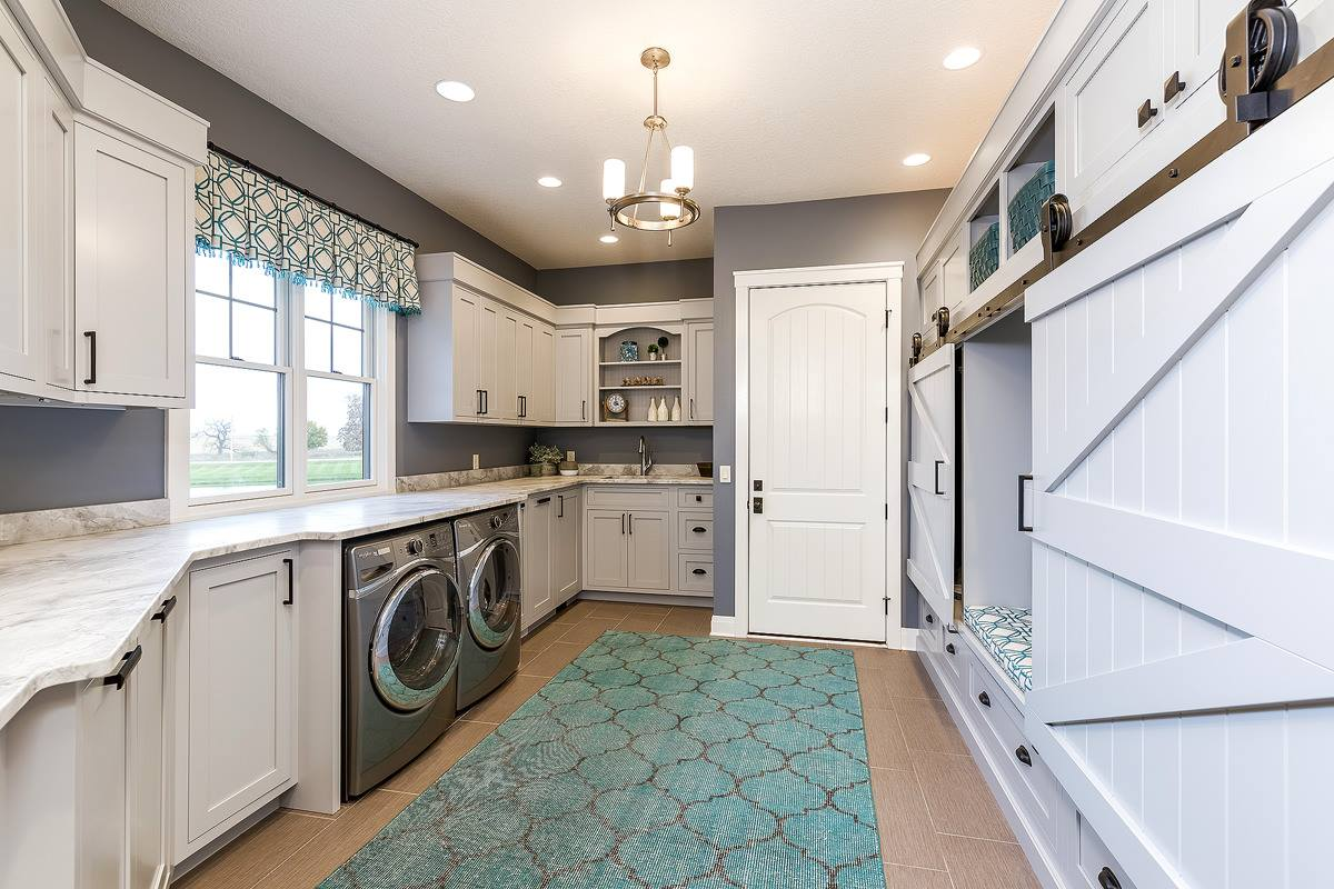 Custom laundry room cabinetry in a new home built by Bob Walter Homes. | VillageHomeStores.com | Photo by Andy Laake, Chipshot Media