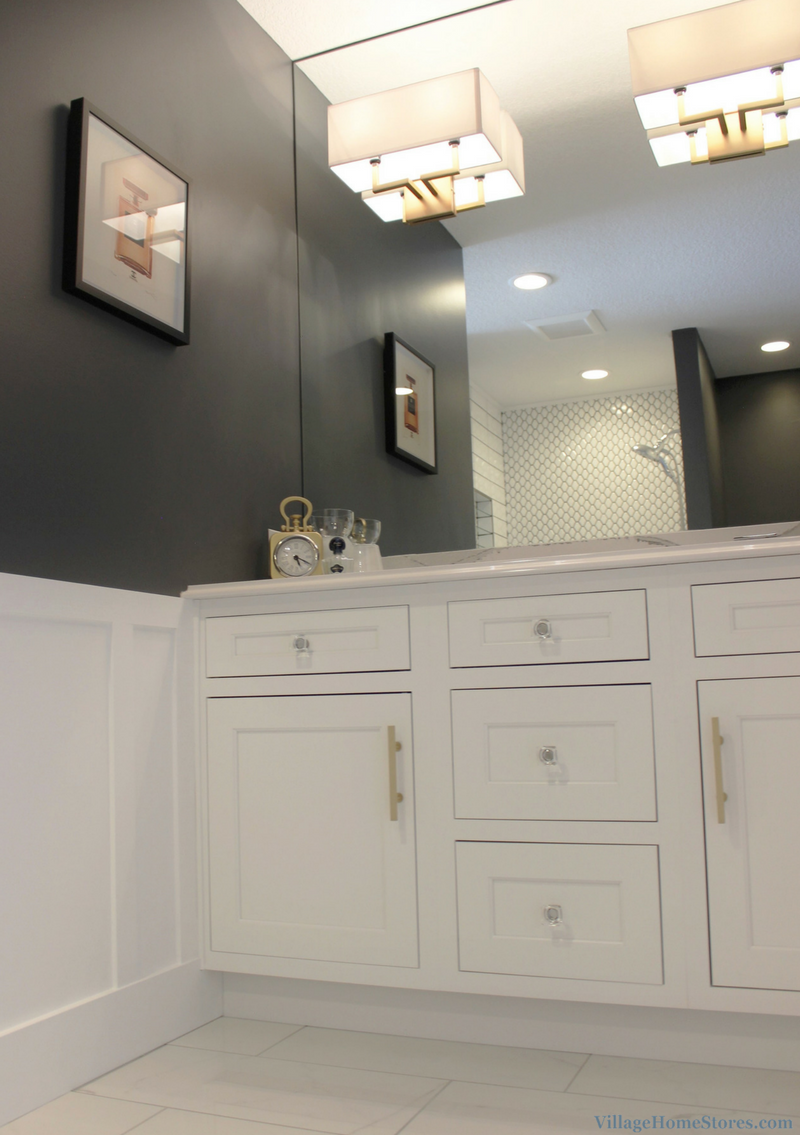 Remodeled Quad Cities bathroom with inset cabinetry by Dura Supreme and Cambria Quartz counters. | VillageHomeStores.com