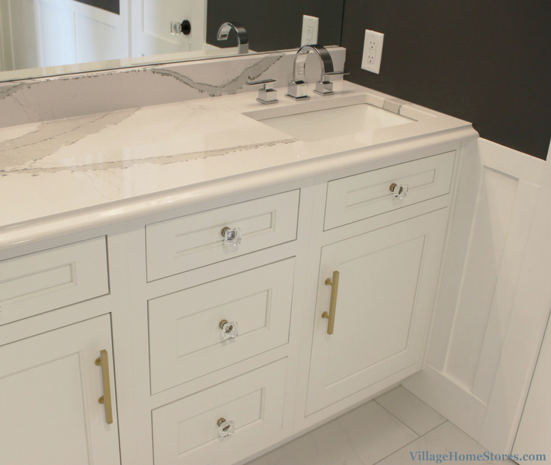 Remodeled Quad Cities bathroom with offset bowl in Brittanicca Cambria Quartz counter. | VillageHomeStores.com