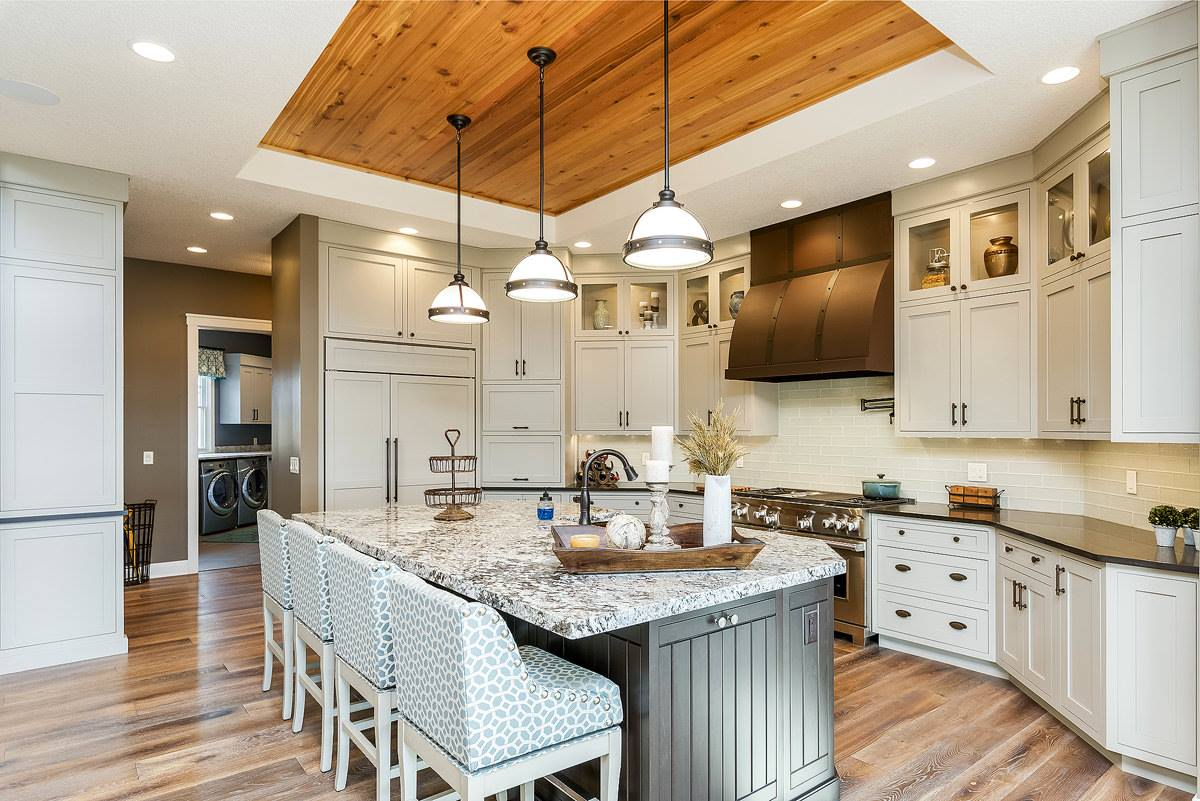 Custom kitchen in Iowa in a new home built by Bob Walter Homes. | VillageHomeStores.com | Photo by Andy Laake, Chipshot Media