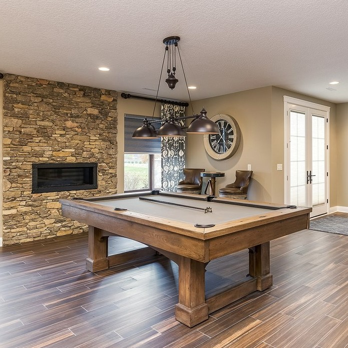 Rec Room in Iowa in a new home built by Bob Walter Homes. Pool table light with pulley. | VillageHomeStores.com | Photo by Andy Laake, Chipshot Media