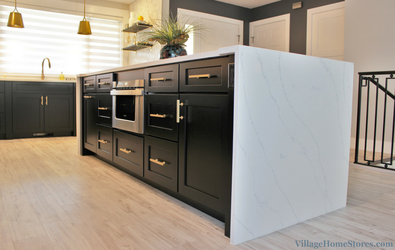 Black and White painted kitchen with waterfalling Hanstone Quartz counters. | VillageHomeStores.com