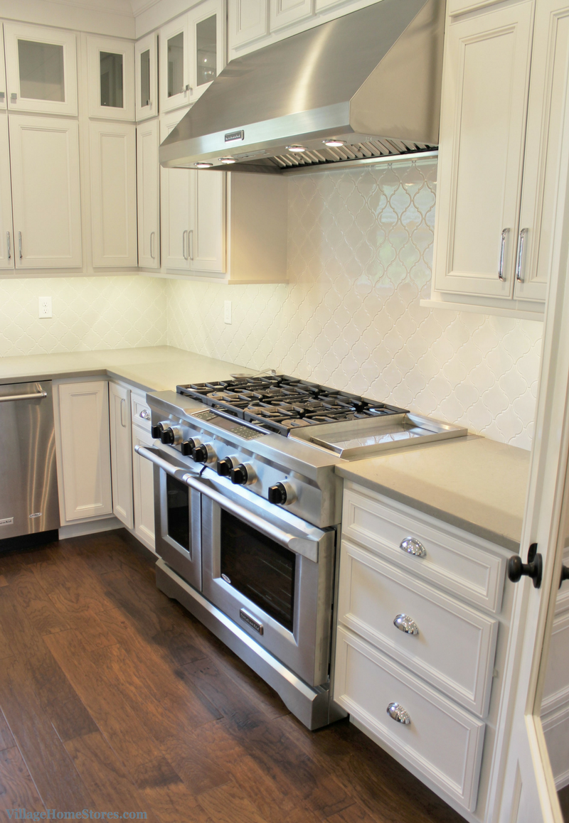 White painted kitchen in a Coal Valley, IL with 48 inch KitchenAid gas range. Home by Hazelwood Homes. | VillageHomeStores.com
